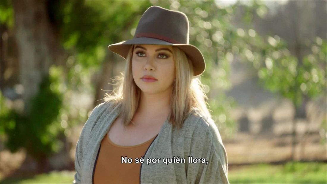 Chiquis at the cemetery